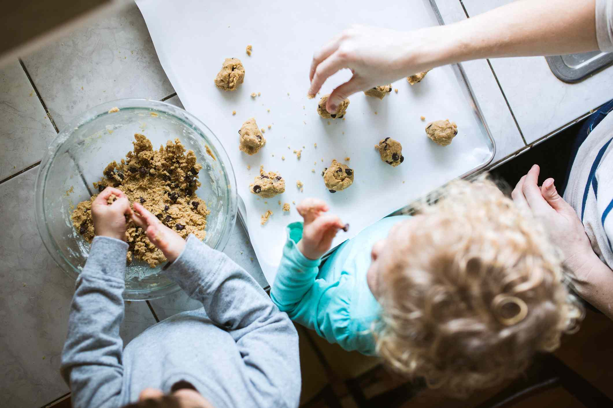 An overhead view of kids making cookies.
