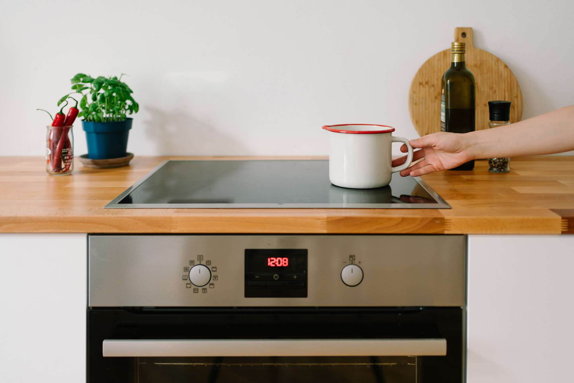 small ceramic pot on a smooth-top cooking surface