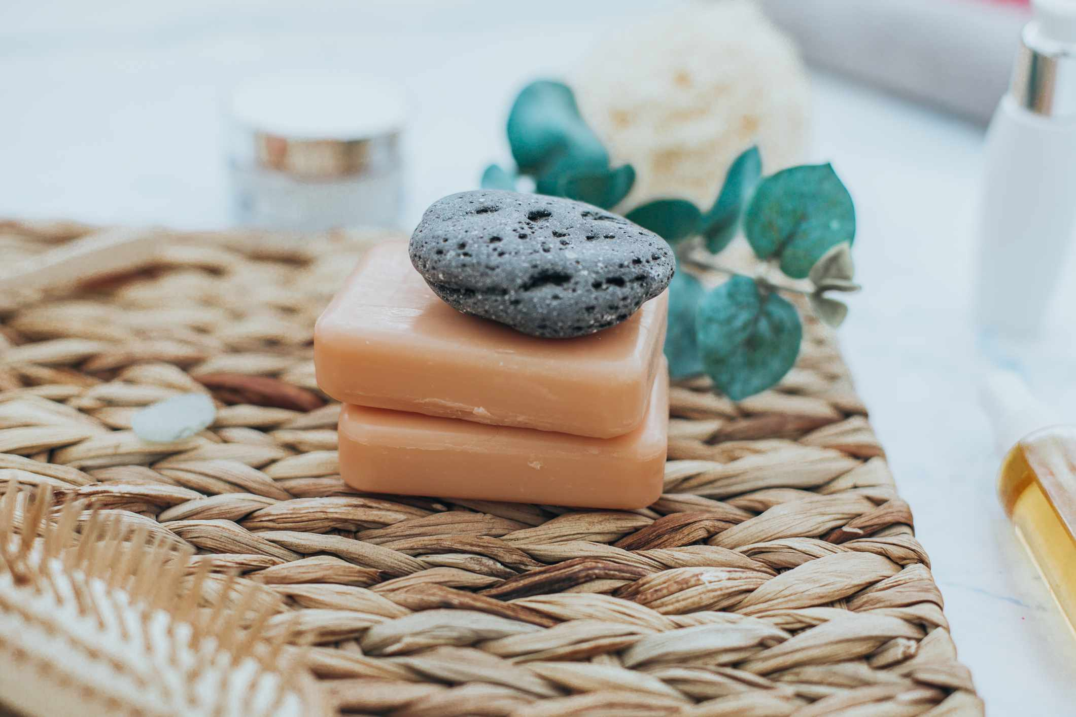 A stack of natural soaps on a counter