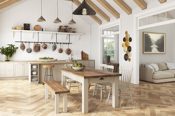 Rustic farmhouse table in a kitchen with exposed beams