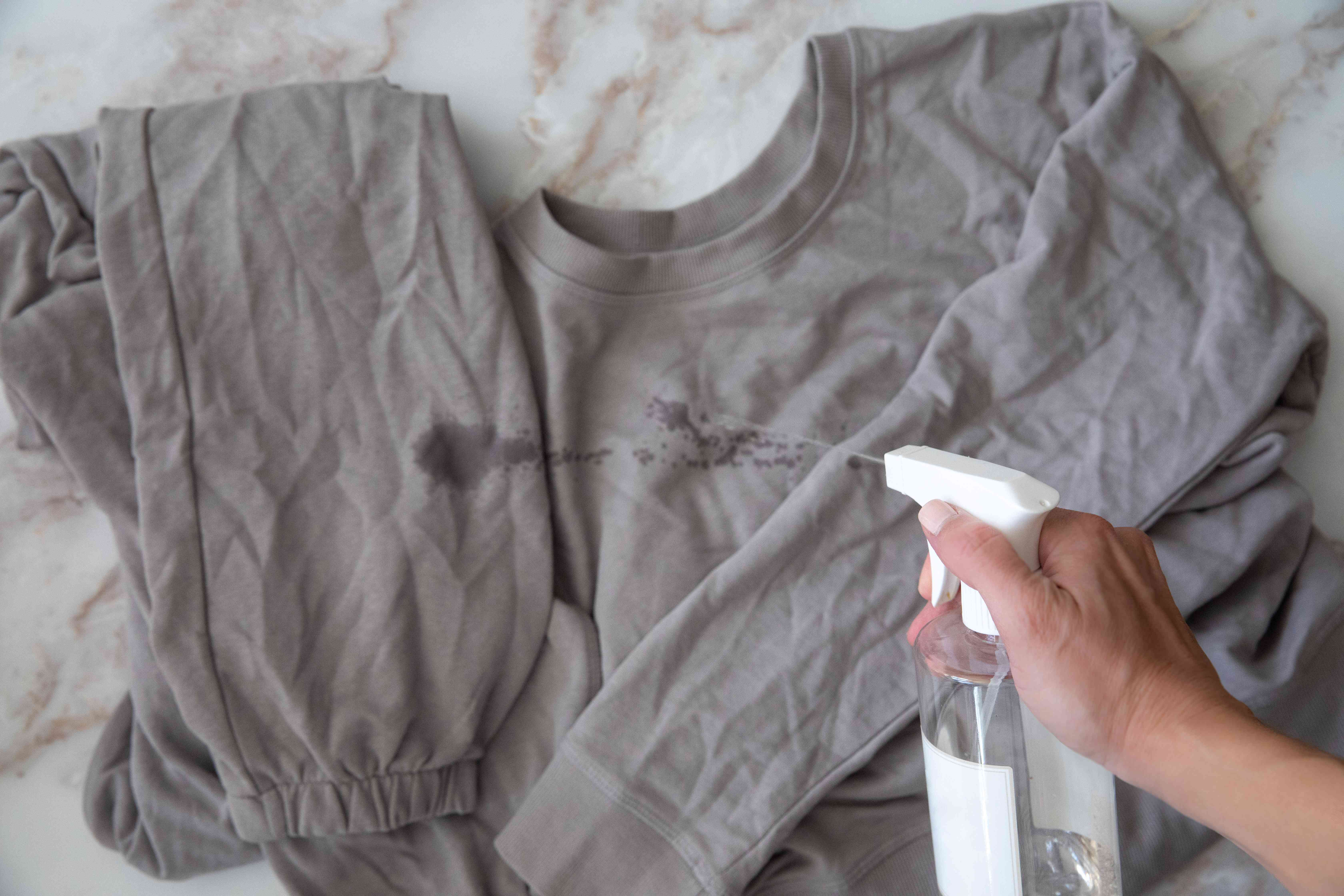 Rubbing alcohol sprayed on gray clothes to kill bugs