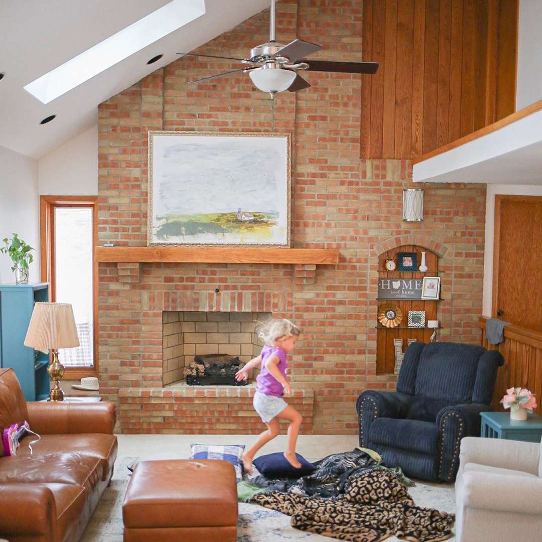 Living room with brick and brown walls