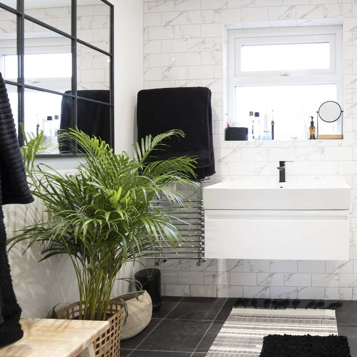 bathroom with large plant