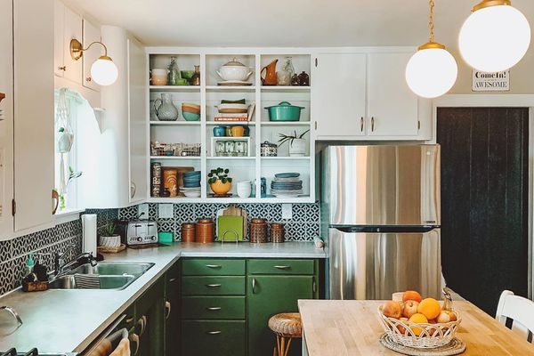 Kitchen with hunter green cabinets
