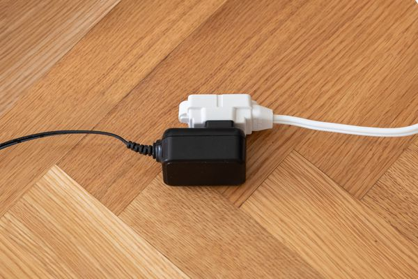 electronic plugged into an extension cord