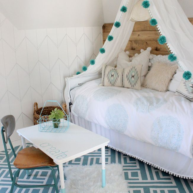 Girl's room with DIY canopy bed featuring pendant light