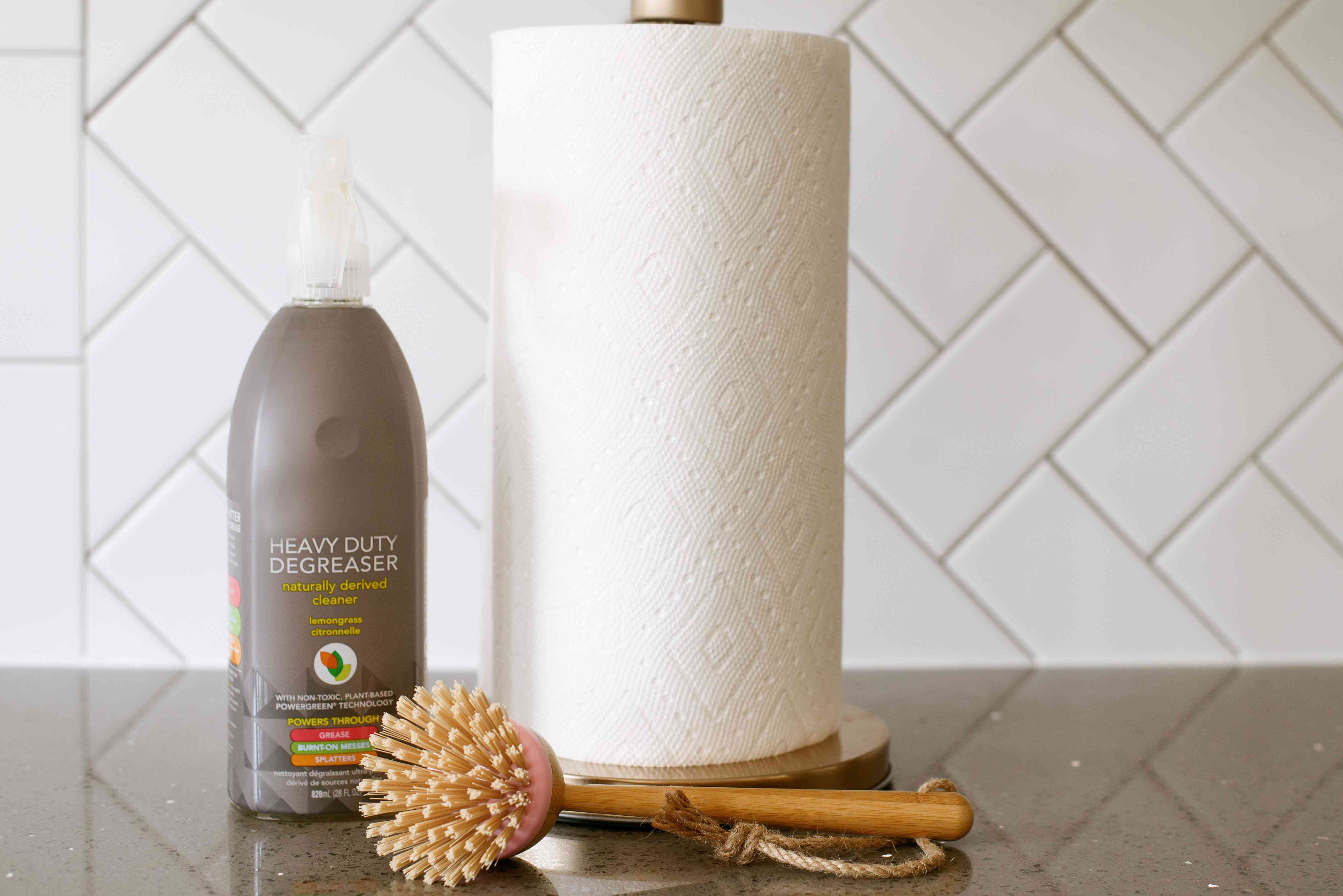 Paper towel roll, scrubbing brush and bottle of heavy duty degreaser to clean exterior and interior of range hood