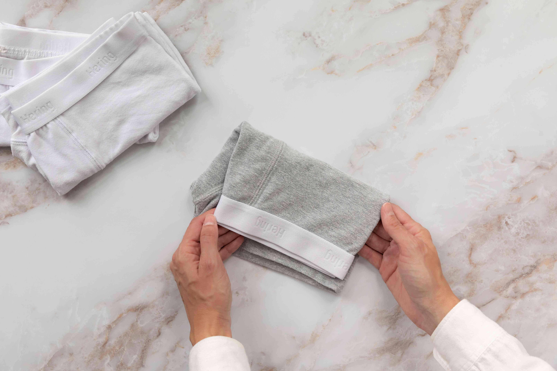 Gray underwear folded horizontally half-way down