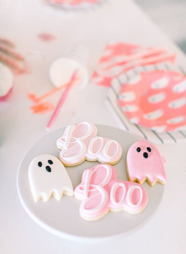"""Boo"" and ghost Halloween cookies on plate"