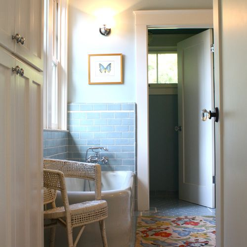 Bathroom with eclectic furnishings and a hexagonal tile pattern