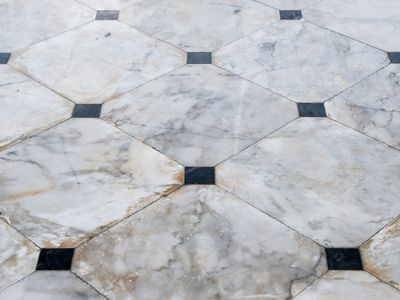 Marble tile floor with the black block.