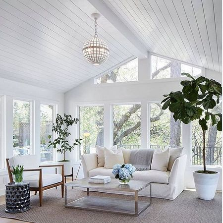 White Sunroom With A Couch