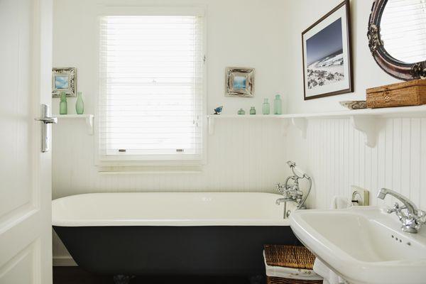 Claw foot bathtub in ornate bathroom