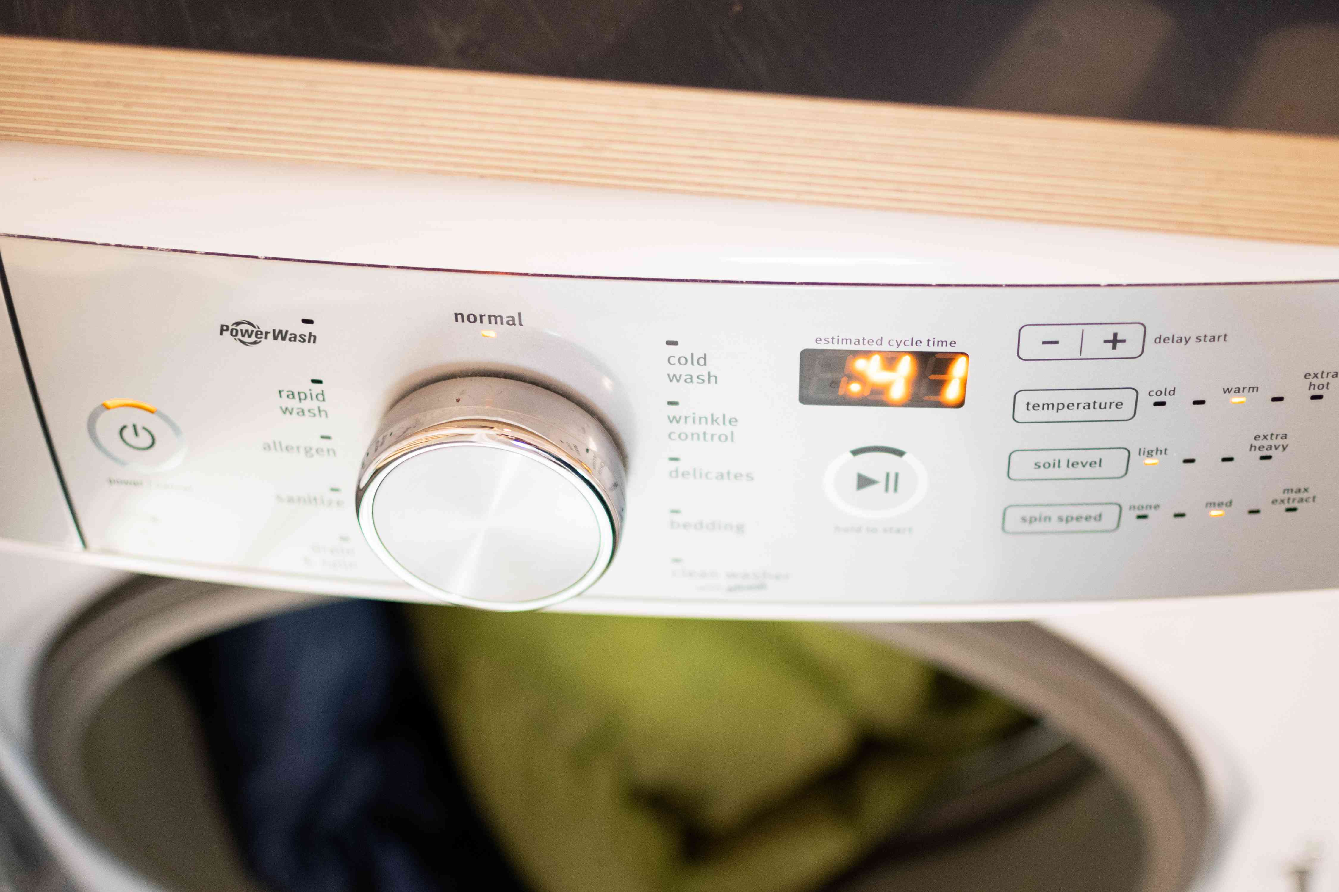 Warm water cycle set on washing machine to clean down coats