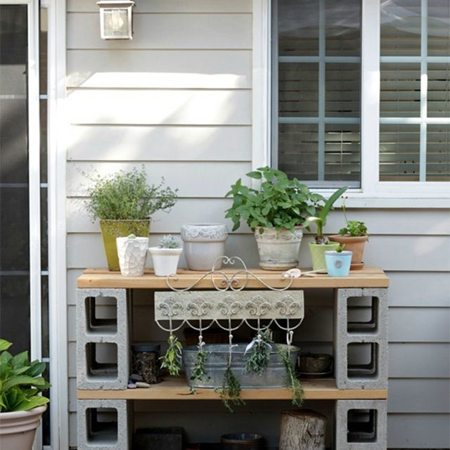 A potting table on a back porch