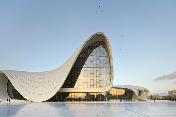Zaha Hadid Architects03 Courtesy of Helene Binet01 Courtesy of Helen Binet 02 Courtesy of Iwan Baan03Heydar Aliyev Center0201As part of the former Soviet Union, the urbanism and architecture of Baku, the capital of Azerbaijan on the Western coast of the Caspian Sea, was heavily influenced by the planning of that era. Since its independence in 1991, Azerbaijan has invested heavily in modernising and developing Baku's infrastructure and architecture, departing from its legacy of normative Soviet Modernism.Zaha Hadid Architects was appointed as design architects of the Heydar Aliyev Center following a competition in 2007. The Center, designed to become the primary building for the nation's cultural programs, breaks from the rigid and often monumental Soviet architecture that is so prevalent in Baku, aspiring instead to express the sensibilities of Azeri culture and the optimism of a nation that looks to the future.Design conceptThe design of the Heydar Aliyev Center establishes a continuous, fluid relationship between its surrounding plaza and the building's interior. The plaza, as the ground surface; accessible to all as part of Baku's urban fabric, rises to envelop an equally public interior space and define a sequence of event spaces dedicated to the collective celebration of contemporary and traditional Azeri culture. Elaborate formations such as undulations, bifurcations, folds, and inflections modify this plaza surface into an architectural landscape that performs a multitude of functions: welcoming, embracing, and directing visitors through different levels of the interior. With this gesture, the building blurs the conventional differentiation between architectural object and urban landscape, building envelope and urban plaza, figure and ground, inHeydar Aliyev Center in Baku, Azerbaijan