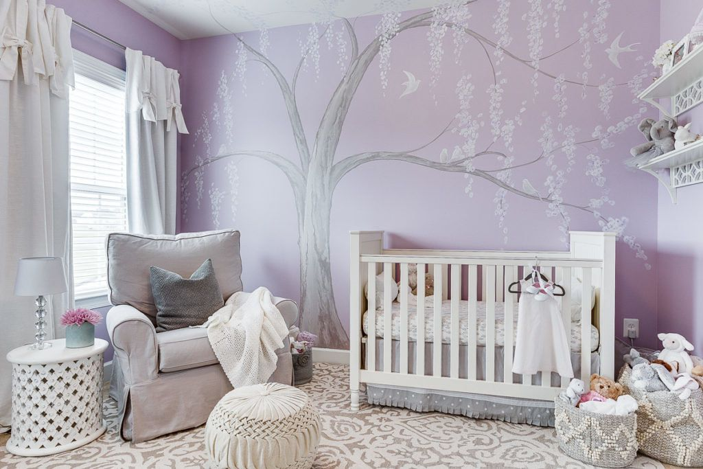pale purple bedroom with white accent furniture and tree mural