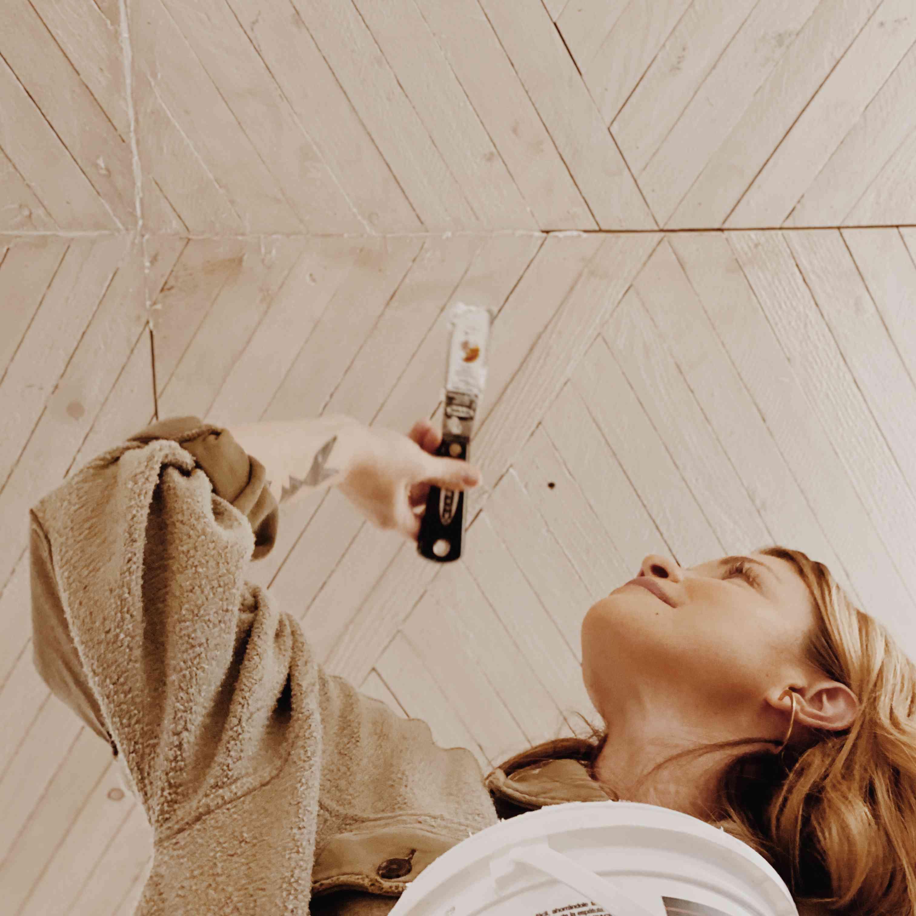 Aleksandra Zee working on ceiling installation in Sonoma, California