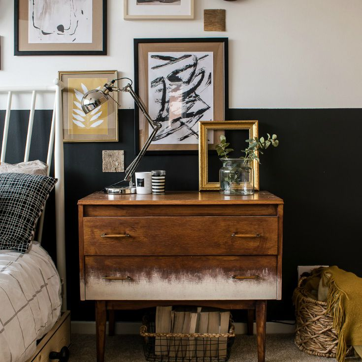 bedroom with rustic side table and frames