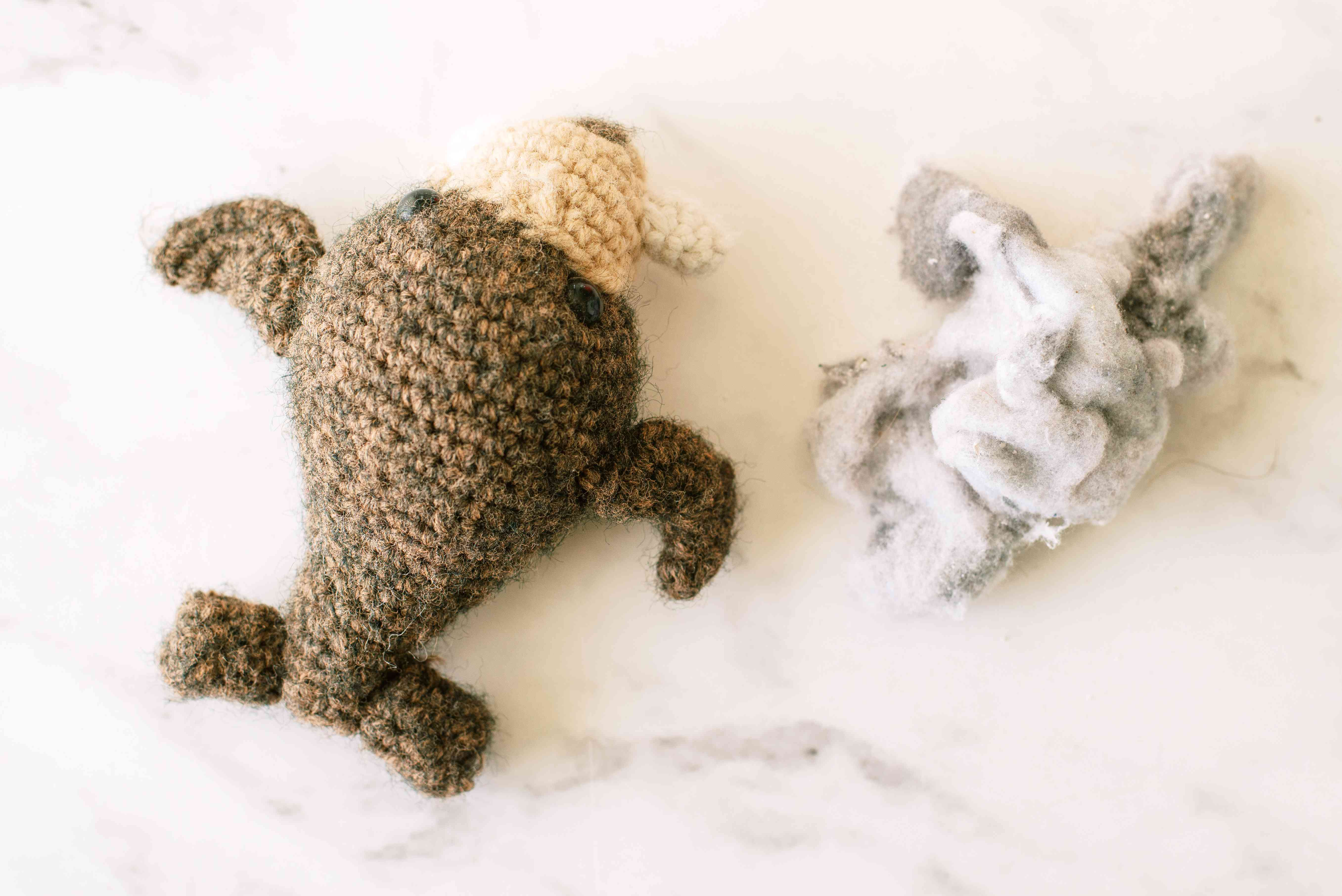 Dryer lint next to sewn walrus toy with lint stuffing