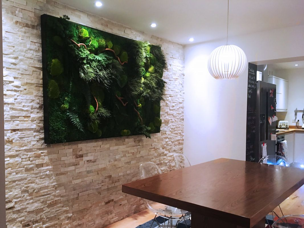 Moss Wall Paired With Stacked Stone Veneer