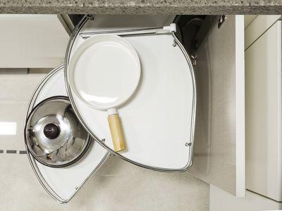 Solution for a kitchen corner storage in a cupboard