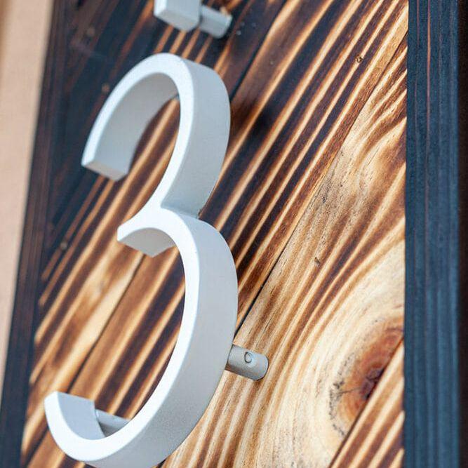 Charred wood address sign.
