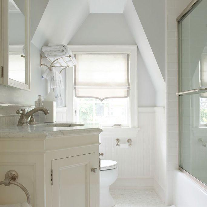 White attic bathroom with walkin shower