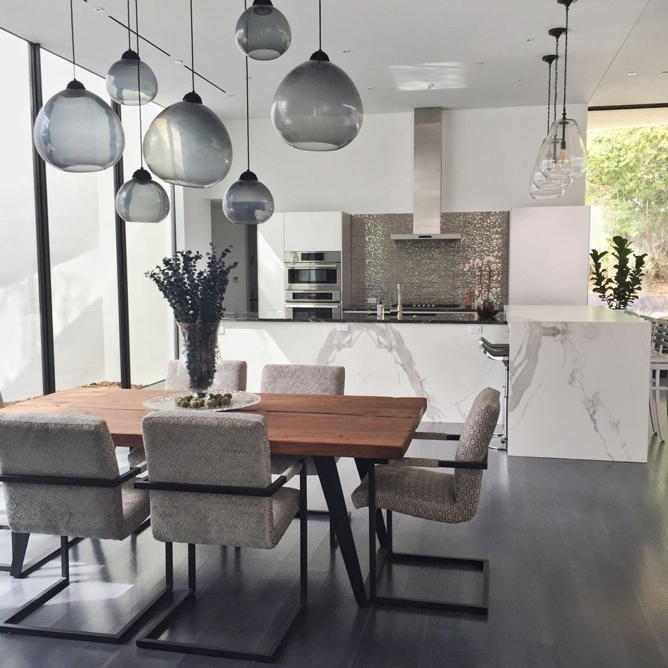 modern dining room and kitchen with blown glass chandelier