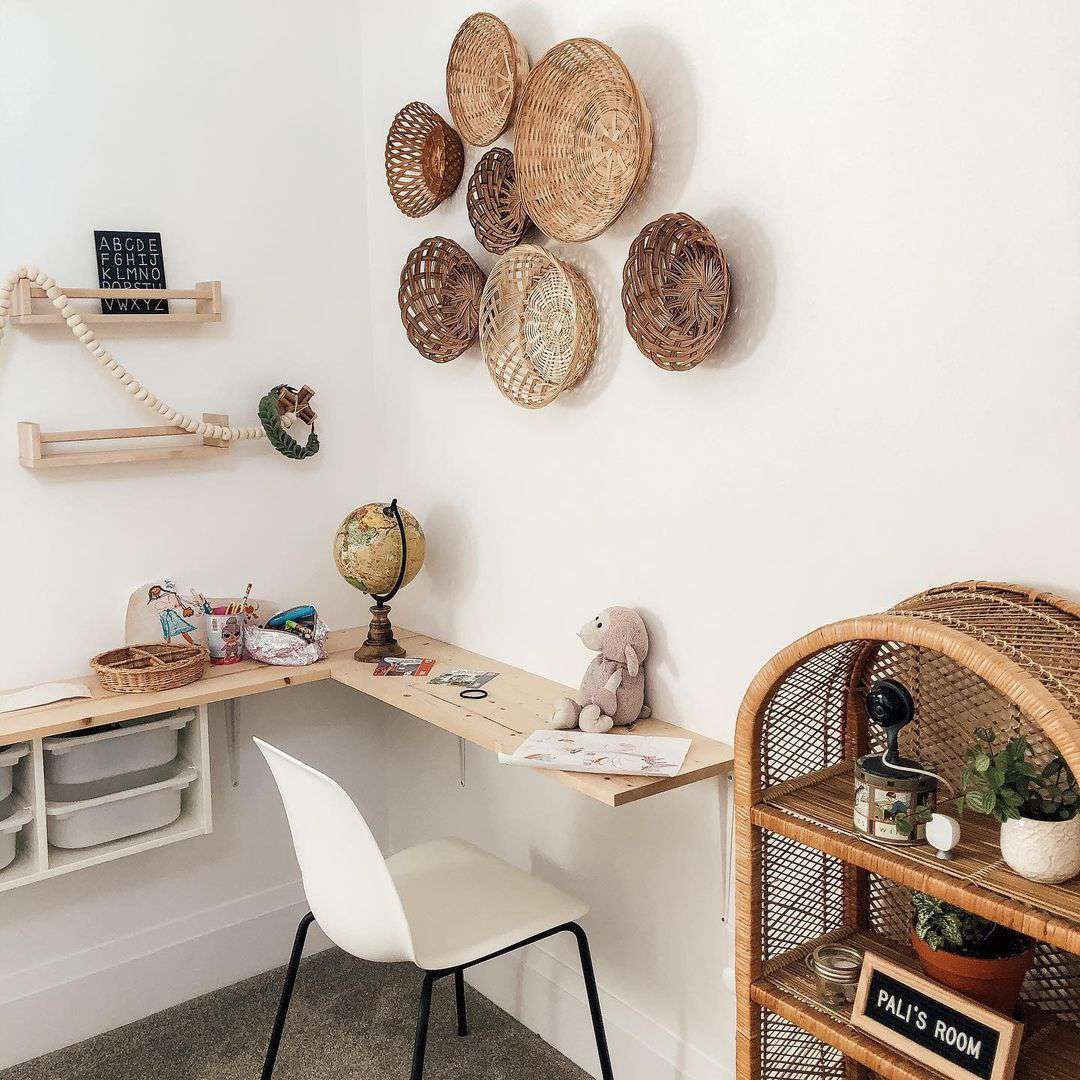 Desk with baskets over it