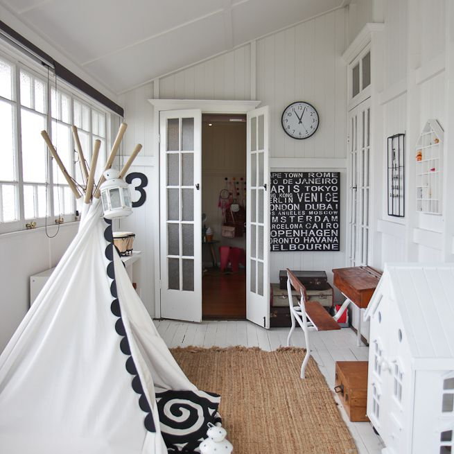 Sunroom with a tent and kids' toys