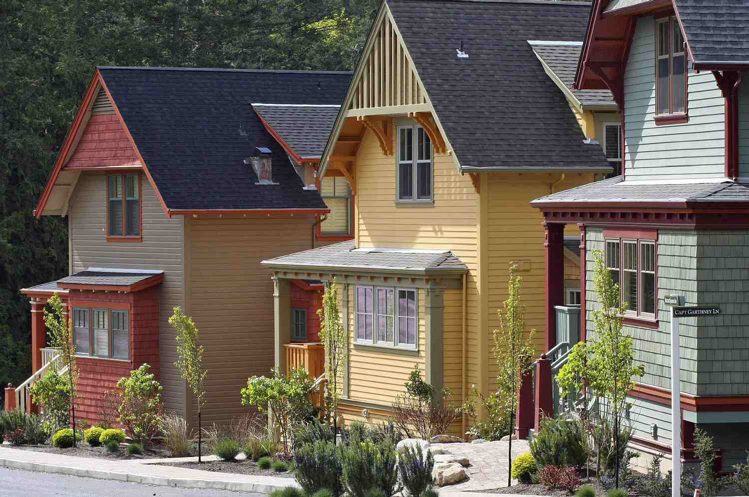Three Colorful Cottages in a Seaside Village