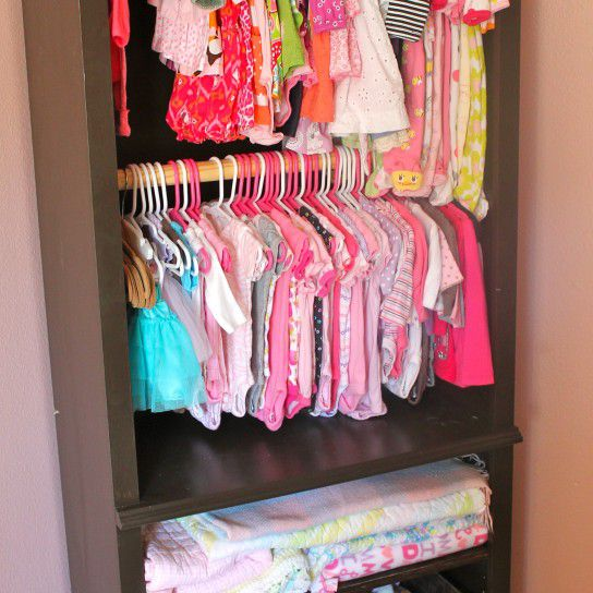 Bookshelf repurposed as a DIY nursery closet