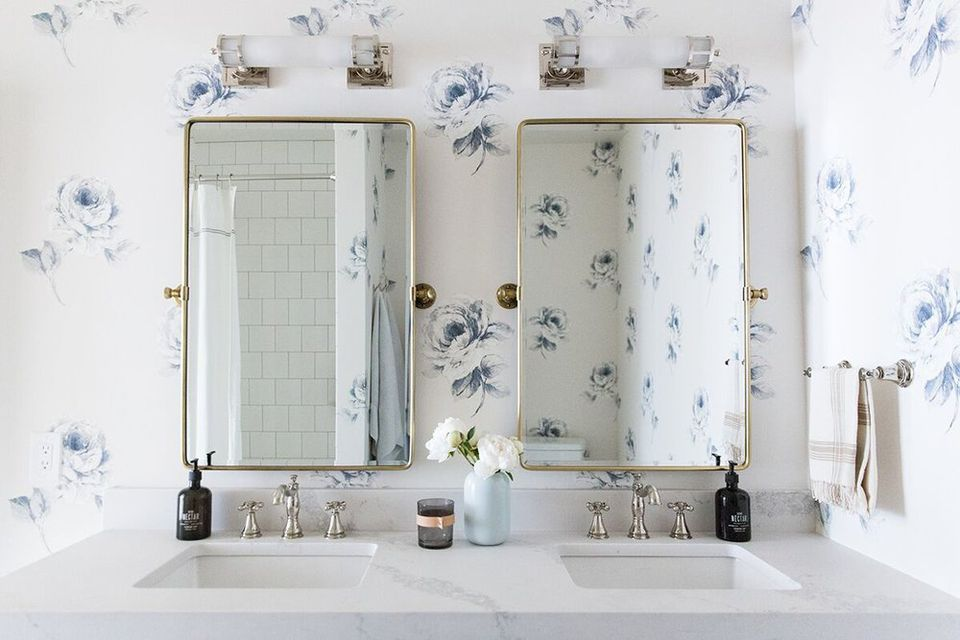 Bathroom vanity with blue flower wallpaper