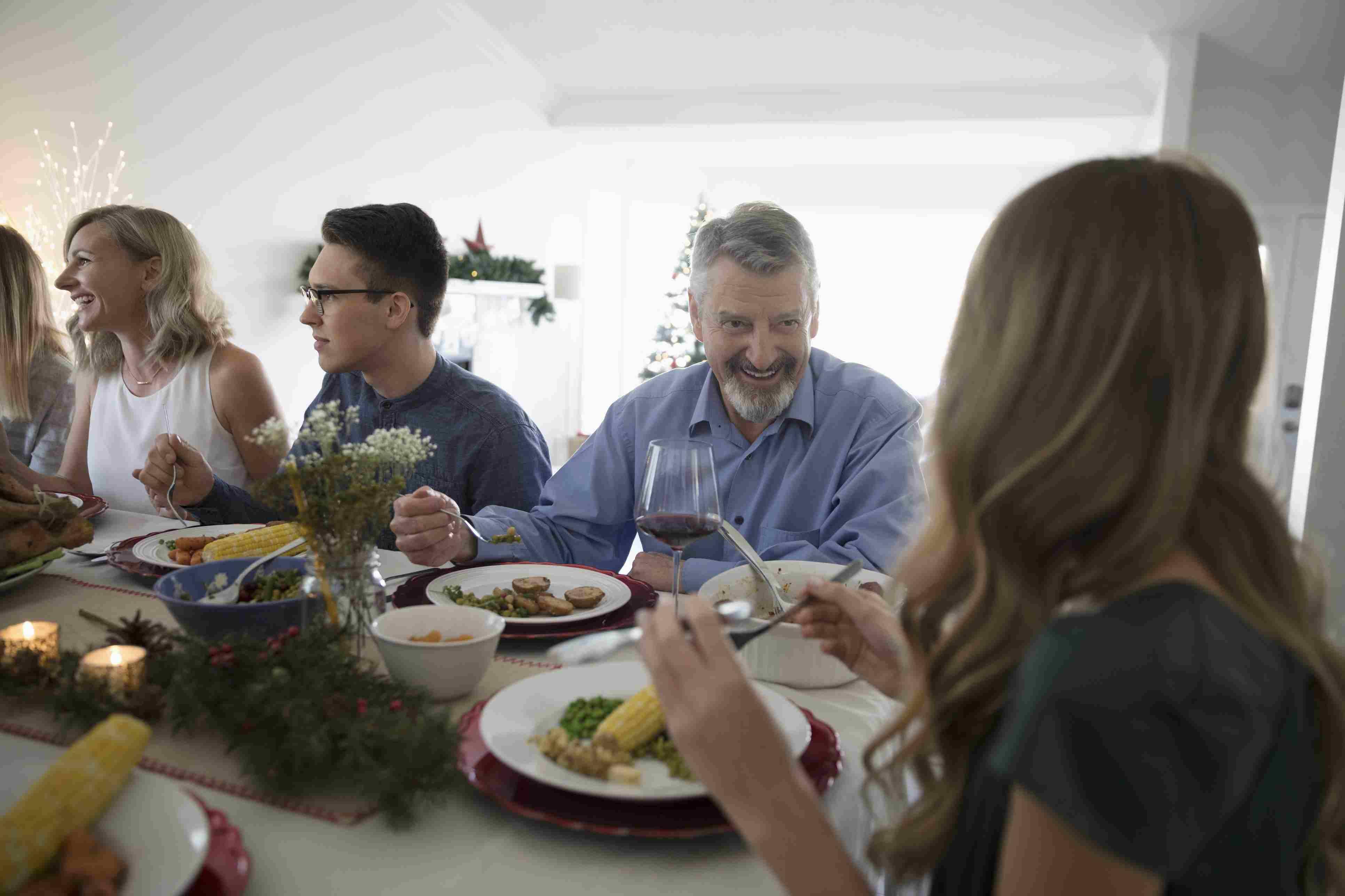 Family enjoying Christmas dinner at table