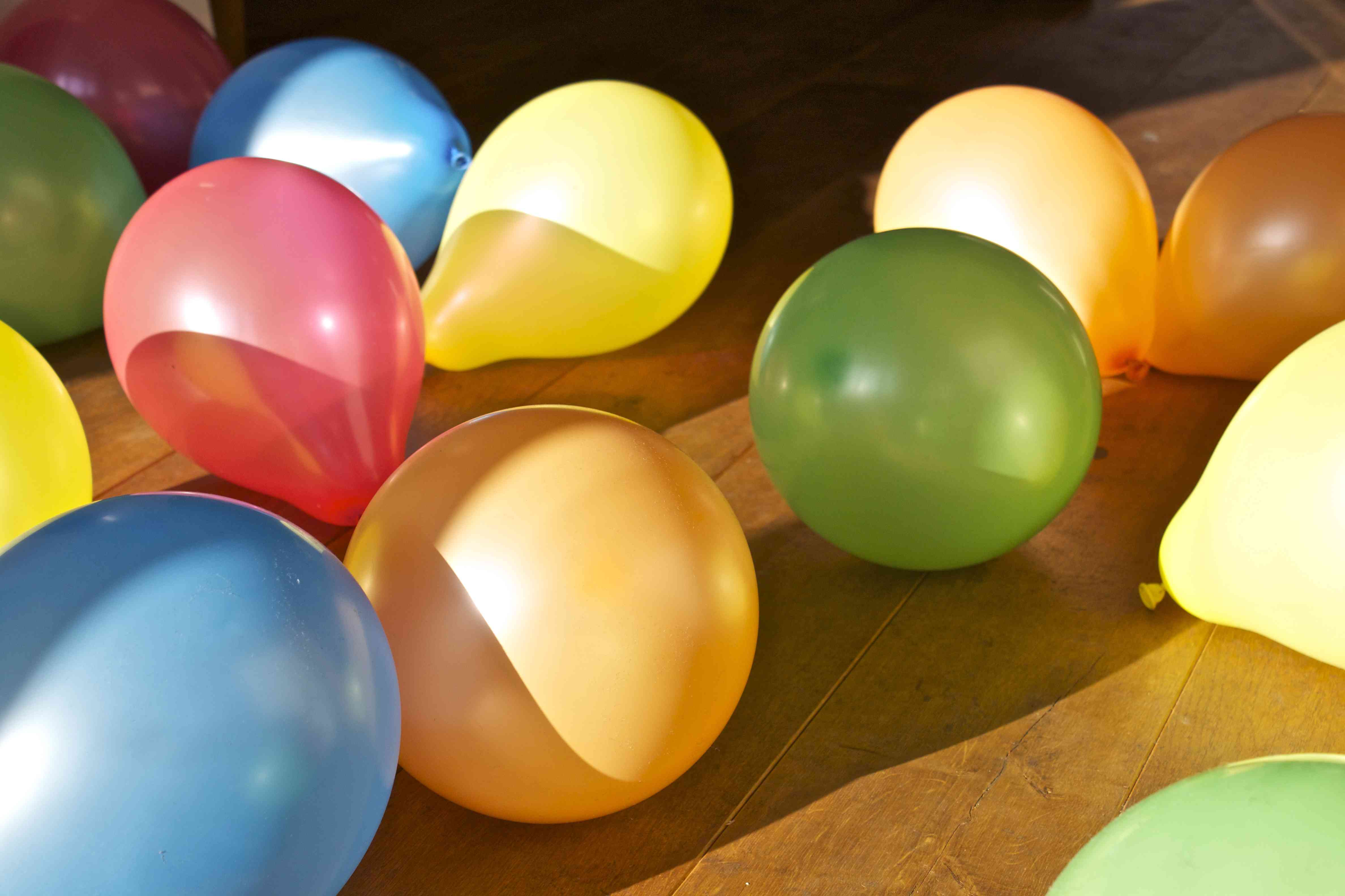 Colorful balloons scattered on floor