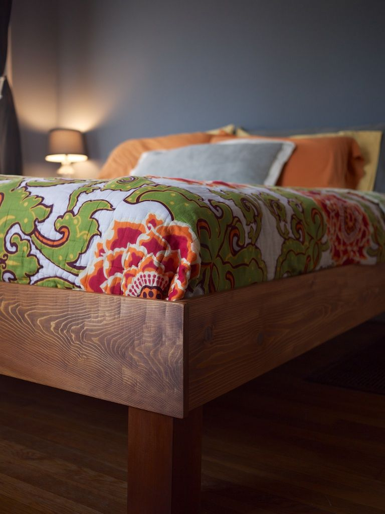 A close-up of a wooden bed
