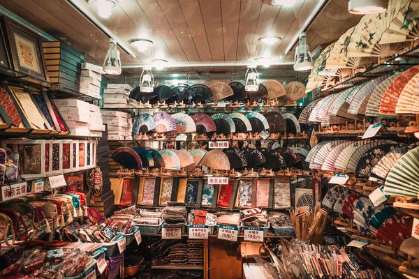 A flea market booth full of hand fans.