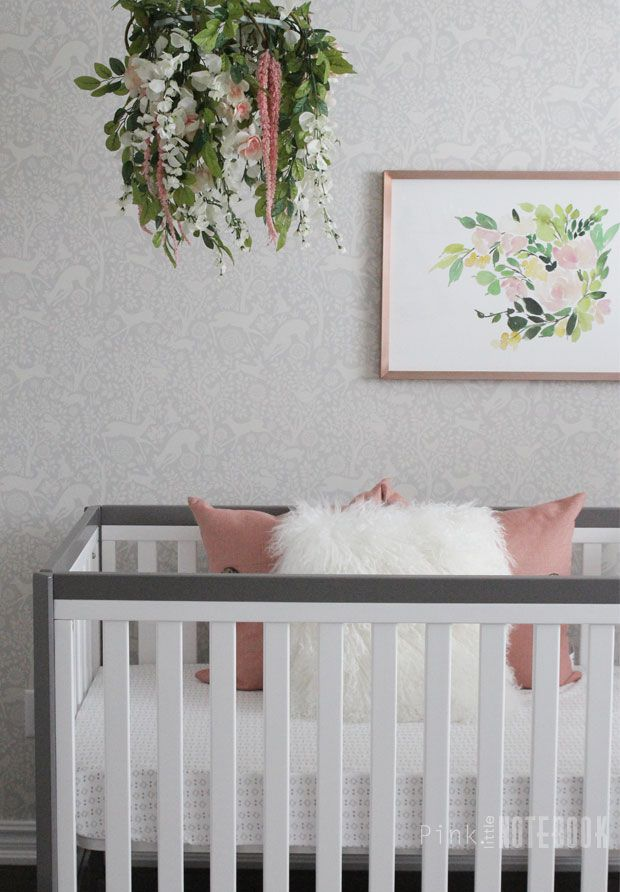Beautiful floral-themed nursery with understated grey floral wallpaper