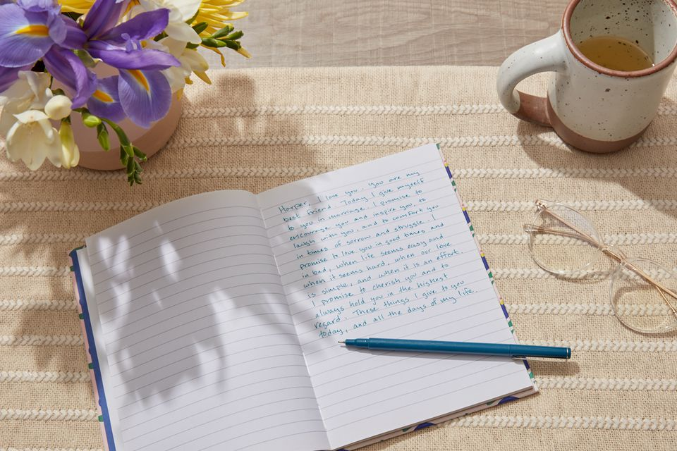 writing personalized wedding vows in a notebook