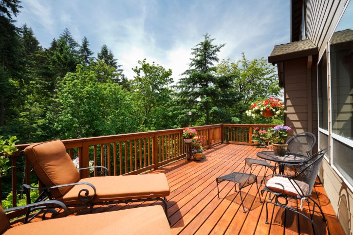 A sunny wooden deck with furniture
