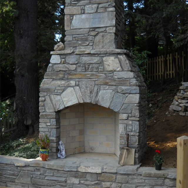 A large outdoor stone fireplace