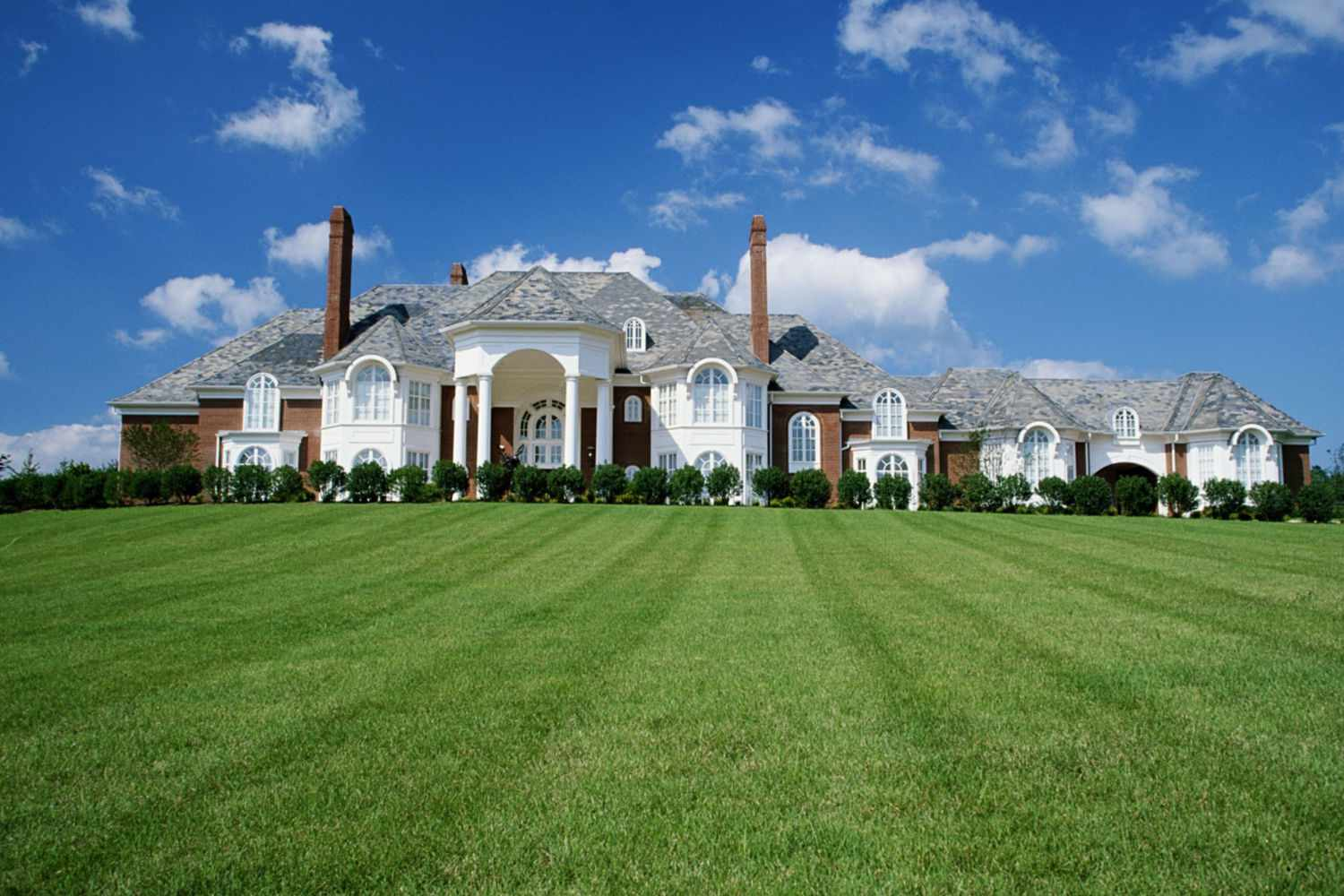 mansion with front lawn
