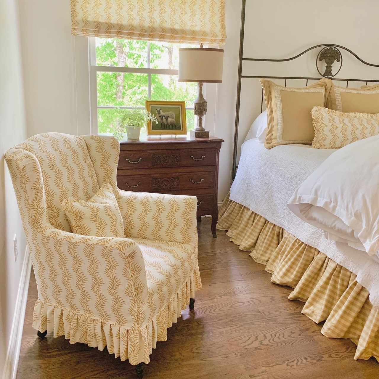 bedroom with yellow and white patterned fabrics