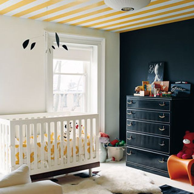 Black, white and yellow nursery with striped ceiling