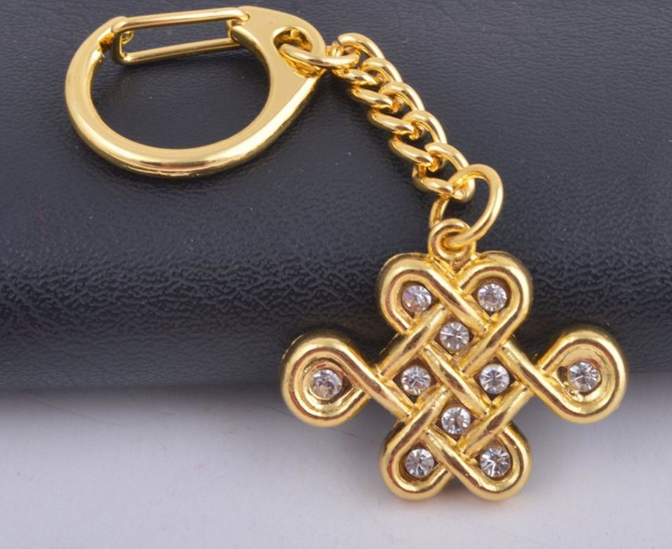 Mystic knot feng shui symbol meaning and use mystic knot golden keychain feng shui good luck amulet aloadofball Choice Image