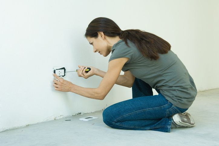 Woman working on outlet