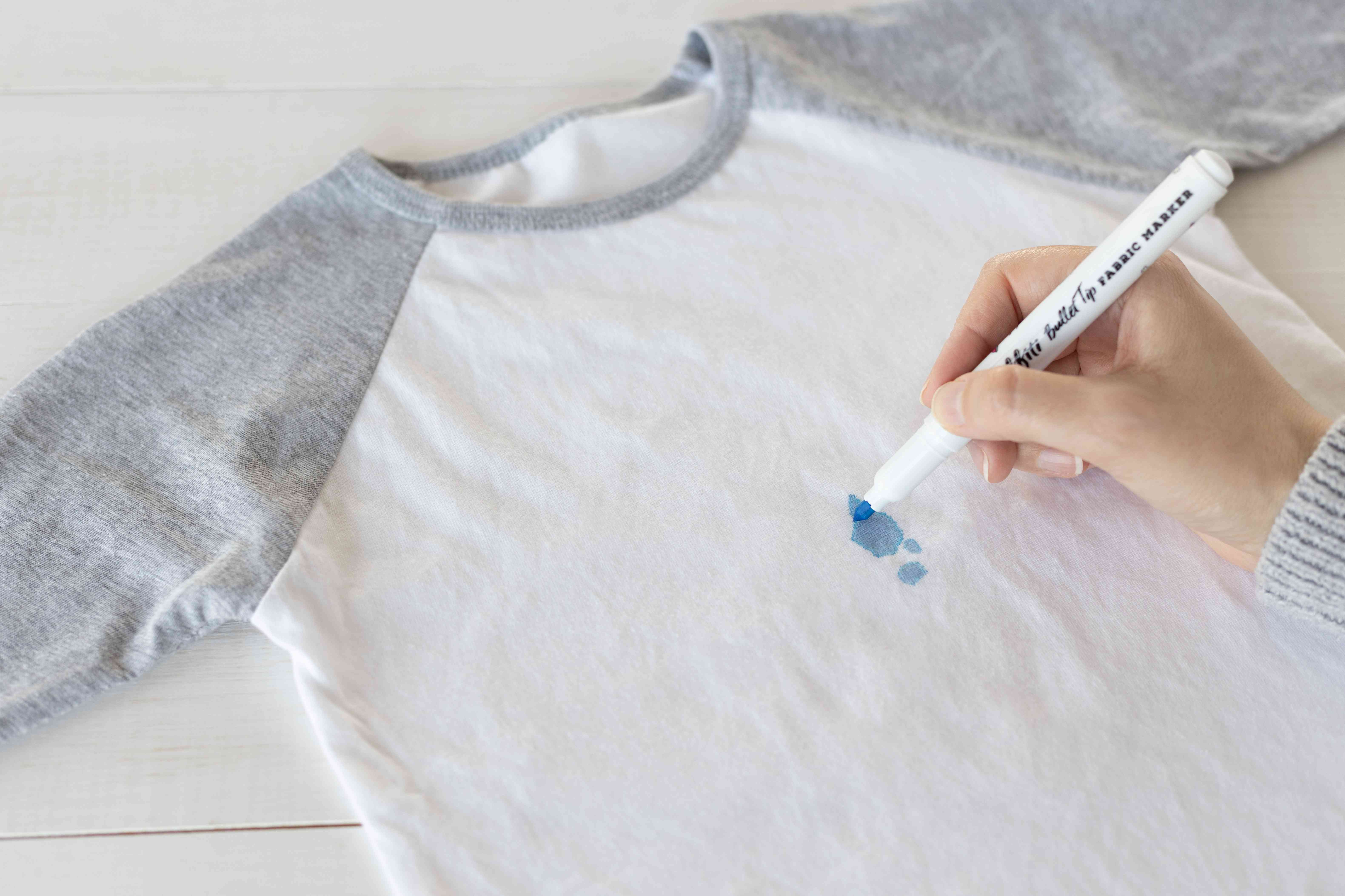 White and gray shirt with blue stain colored in with fabric marker