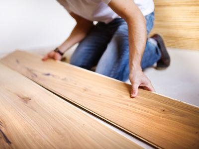 Man laying floor board
