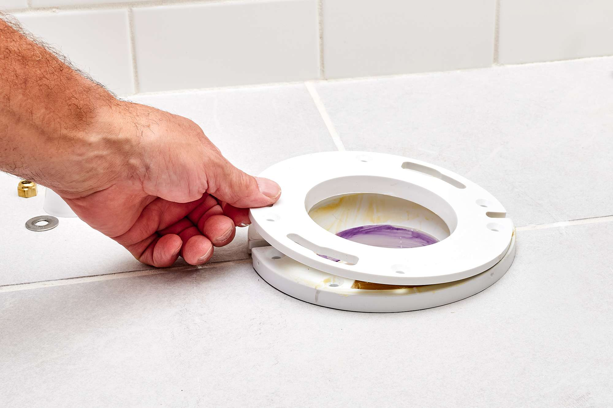 White flange extender tested and flushed with floor surface